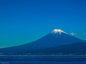 Here's an actual view of Mt. Fuji across Suruga Bay. Source: Wikimedia Commons, photographer: Shinichi Morita