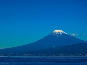 Here's an actual view of Mt. Fuji across Suruga Bay. Source: Wikimedia Commons, photographer: Shinichi Morita